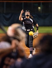 Avery Beauchaine (8) pitches during the Tate vs Escambia softball game at Escambia High School on Tuesday, Feb. 25, 2020.