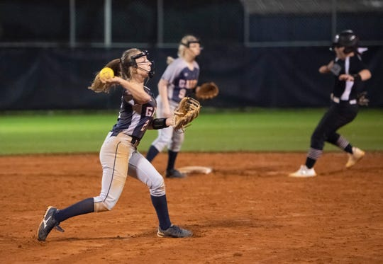 Shortstop Hailey Walker (2) throws to first for the 3rd out in the top of the 5th inning during the Tate vs Escambia softball game at Escambia High School on Tuesday, Feb. 25, 2020.