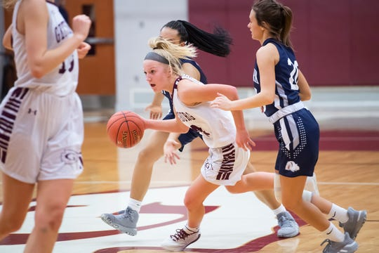 Gettysburg's Anne Bair dribbles through traffic during the District 3 Class 5A semifinals against West York on Tuesday, Feb. 25, 2020. The Warriors won, 48-38.