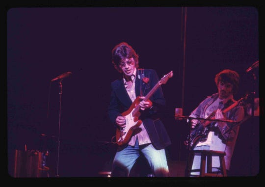 Robbie Robertson onstage in a scene from 'Once Were Brothers.'