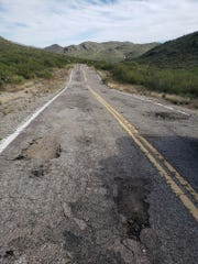 Potholes and rough pavement are nearly unavoidable on Colossal Cave Road in Pima County on Oct. 30, 2019.