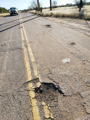 Potholes and rough pavement pepper Navajo Trail in Pima County, near the Cochise County border, on Jan. 30, 2020.