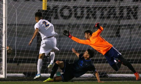 Carl Hayden Falcons Kevin Noria (2) scores the team's second goal on the Sunnyside Blue Devils as Sunnyside's Carlos Arias (9) and Sunnyside   goalkeeper Jonathan De la paz are short to stop it during the 5A boys state soccer championship game hosted at Mountain View High School in Marana, on Feb. 25, 2020.