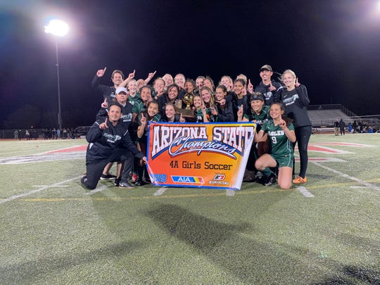 Flagstaff High School celebrates at midfield after winning the 4A girls soccer state championship game Tuesday night in penalty kicks at Gilbert Williams Field High School.