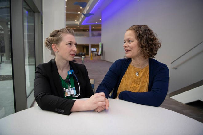Kate McKillip, MD, left, an assistant professor in Creighton University's School of Medicine, catches up with her friend and former academic advisor Brooke Kowalke, PhD. The two share a special bond and passion for the medical humanities, deepened by loss.