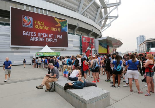 Soccer fans line up outside B.C. Place Stadium for the final of the FIFA 2015 Women's World Cup between United States and Japan. The Arizona Diamondbacks have looked into the possibility of playing baseball games at the stadium in Vancouver, should the need arise.