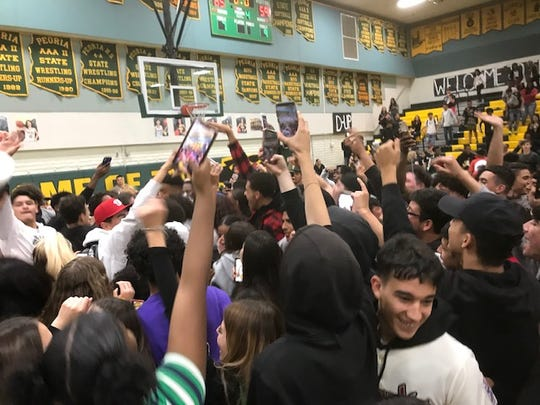 Peoria students celebrate a win in the 2020 Arizona high school basketball playoffs.