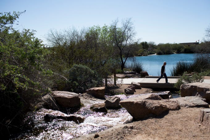 A visitor walks through the Veterans Oasis Park in Chandler on Feb. 25, 2020.