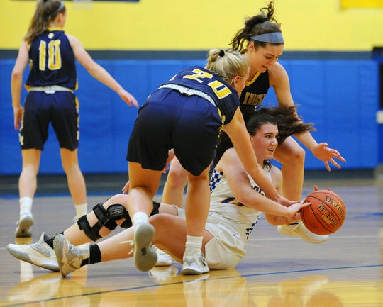 NL's Ashlyn Messinger (13) battles Eastern York's Addison Malone (20) and Lilyana Campbell (1) for a loose ball during the first quarter of action.