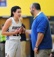 NL's Zara Zerman talks with her head coach Kenneth Battistelli during the fourth quarter of action.