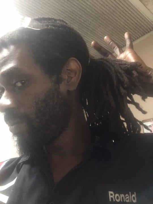 Ronald Dieudonne shows off his hair.