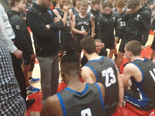 Cedar Crest coach Tom Smith gives his team a few last-minute instructions before the start of the second half.