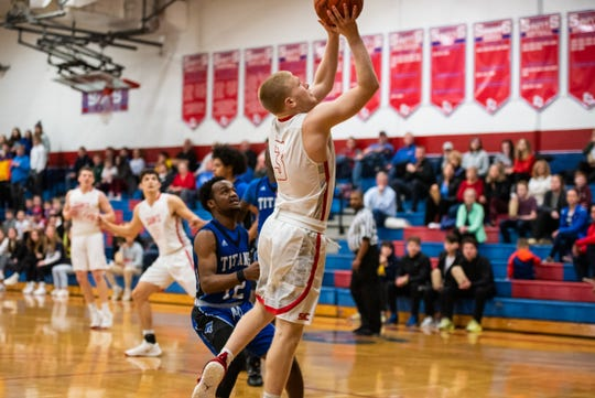 St. Clair's Sean Donaldson jumps to score during Round 2 of the MAC Blue/Gold Tournament against Warren Woods-Tower Tuesday, Feb. 25, 2020, at St. Clair High School.