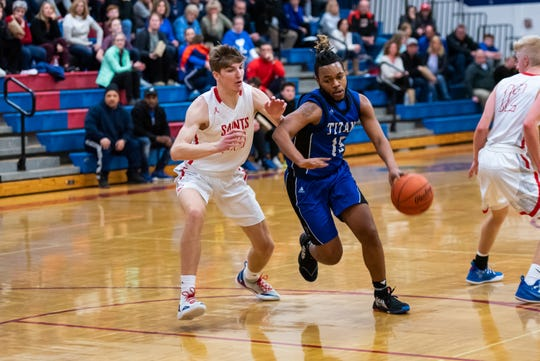 St. Clair's Colin Zimmer (left) defends against Warren Woods-Tower's Dwayne Ware during Round 2 of the MAC Blue/Gold Tournament Tuesday, Feb. 25, 2020, at St. Clair High School.