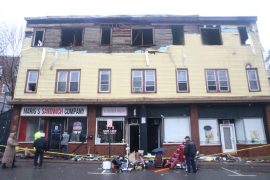 Shop owners arrive to assess damage from Tuesday's fire on Market street on February 26, 2020.