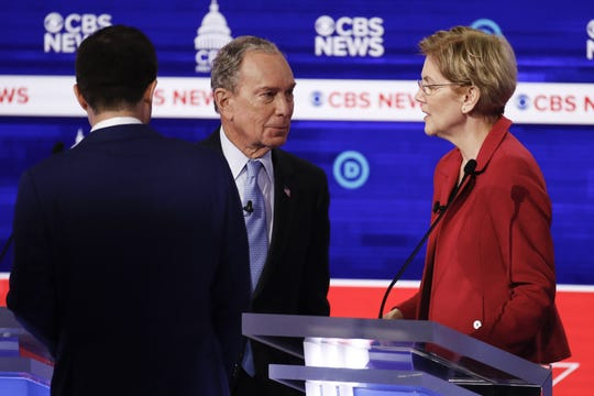 Democratic presidential candidates, former New York City Mayor Mike Bloomberg, center, talks with Sen. Elizabeth Warren, D-Mass., right, on stage at the end of the Democratic presidential primary debate at the Gaillard Center, Tuesday, Feb. 25, 2020, in Charleston, S.C., co-hosted by CBS News and the Congressional Black Caucus Institute. On the left is former South Bend Mayor Pete Buttigieg. (AP Photo/Patrick Semansky)