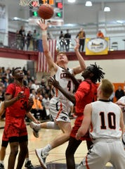 Central York's Gabe Guidinger, center, will play NCAA Division III college basketball in Minnesota.