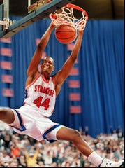 "John Wallace, New York's ""Mr. Basketball'' while at Greece Athena where he led Trojans to a state title, went to Syracuse and led Orange to 1996 NCAA national title game where SU nearly upset powerhouse Kentucky."