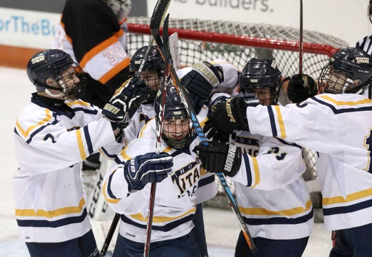 Webster Thomas celebrates a first period goal.