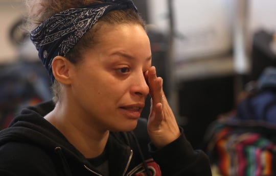 Barbara Rivera, Rochester, wipes away tears as she recounts the struggles of living in an apartment with a crumbling ceiling and roaches, all while trying to raise her two children, as she moves back into the Apartments at Thurston Village at 447 Thurston Road in Rochester Wednesday, Feb. 26, 2020.