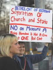 Lillian Brown holds a sign Monday, Feb. 24, 2020, at the intersection of Churn Creek Road and College View Drive during the No on Measure A rally.