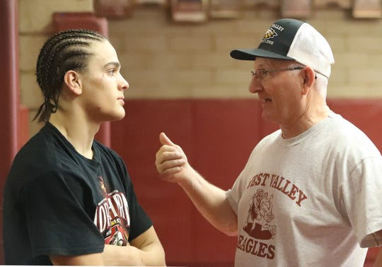 West Valley wrestler Rocky Raby listens to coach Dan Eckley during Eckley's last practice at the high school on Tuesday, Feb. 25, 2020.