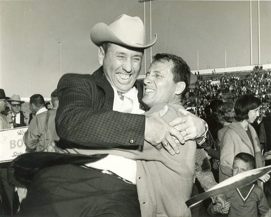 San Angelo Central football coach Emory Bellard (right) hugs Mickey Rathbone after the Bobcats won the state title in football in 1966.