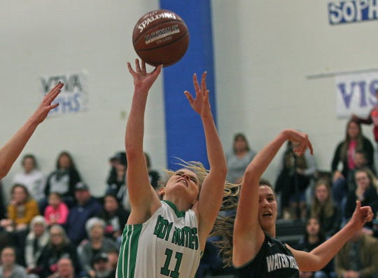 Jadyn Feitshans, center, puts up a shot for Blackwell during a playoff game against Water Valley on Tuesday, Feb. 25, 2020.