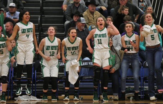 Players for Blackwell celebrate a score during a game against Water Valley on Tuesday, Feb. 25, 2020.
