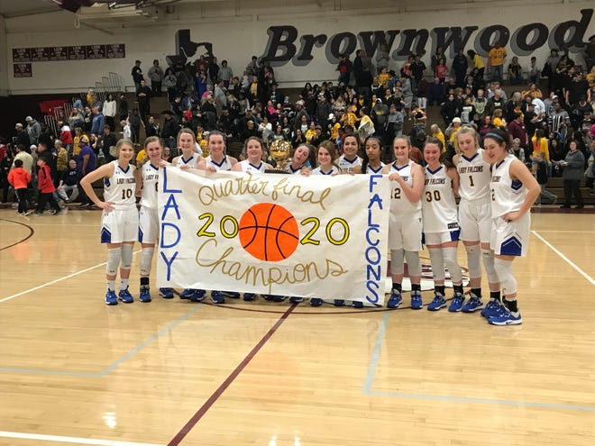 The Veribest High School girls basketball team poses with a banner celebrating its regional quarterfinal playoff win over Santa Anna on Tuesday, Feb. 25, 2020.