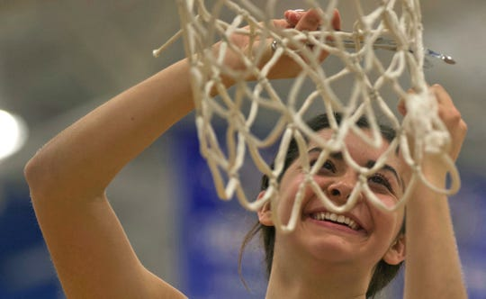 Madison Solis cuts down part of the net after Blackwell defeated Water Valley to advance in the playoffs Tuesday, Feb. 25, 2020.