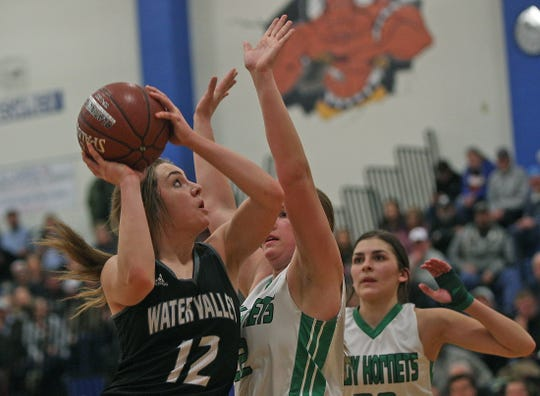 Kalysta Minton-Holland, left, drives to the basket for Water Valley during a playoff game against Blackwell on Tuesday, Feb. 25, 2020.