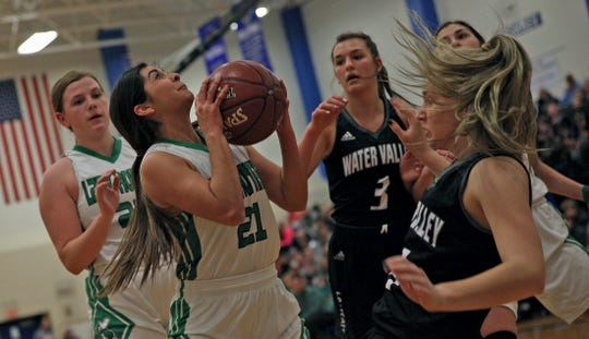 Madison Solis, second from left, drives to the basket for Blackwell during a playoff game against Water Valley on Tuesday, Feb. 25, 2020.