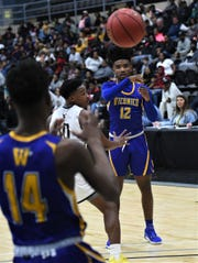 Wicomico's Tawain Hardy sends a pass to Antwan Wilson  during the Bayside Championship on Tuesday, Feb. 25, 2020.