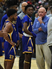 Wicomico head coach Butch Waller speaks with his team during the Bayside Championship on Tuesday, Feb. 25, 2020.