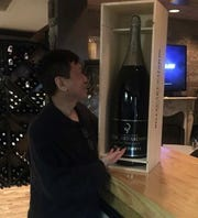 Kuan Lim, owner of Lucky Palace, tastes wine from his award-winning collection. Lucky Palace is a semifinalist in the 2020 James Beard Awards in the category of Outstanding Wine Program.
