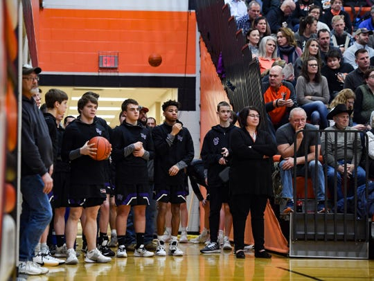 The Dakota Valley boys basketball team waits off-court to warm up in the final minutes of the girls' game against Lennox on Tuesday night, Feb. 25, at Lennox High School.