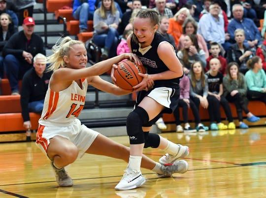Teagan Sanculi of Lennox and Rachel Rosenquist of Dakota Valley fight for the ball during their game on Tuesday night, Feb. 25, at Lennox High School.