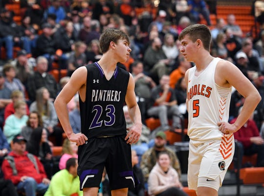 Paul Bruns of Dakota Valley and Josh Arlt of Lennox talk briefly between plays in their game on Tuesday night, Feb. 25, at Lennox High School.