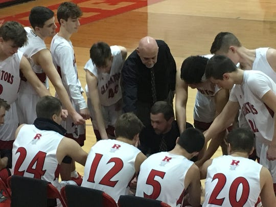 Riverheads coach Chad Coffey talks to his team during a timeout Tuesday in the Region 1B boys basketball quarterfinals.