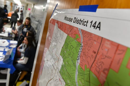 A map outlines precincts in House District 14A during DFL caucuses Tuesday, Feb. 25, 2020, at North Junior High School in St. Cloud.