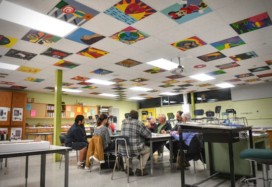 People gather in the art room at the beginning of DFL caucuses Tuesday, Feb. 25, 2020, at North Junior High School in St. Cloud.
