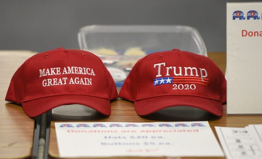 Hats supporting Donald Trump were on display at the Minnesota Senate District 14 Republican caucus Tuesday, Feb. 25, 2020, at Apollo High School.