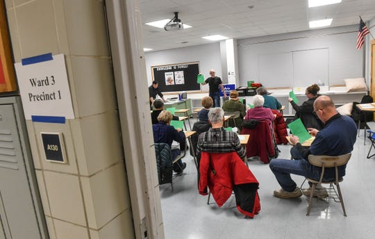 People gather in a classroom during the start of DFL precinct caucuses Tuesday, Feb. 25, 2020, at North Junior High School in St. Cloud.