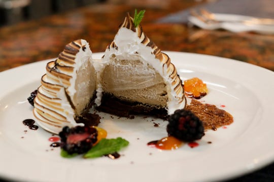 Sylvia Gould's Vietnamese coffee baked Alaska, one of the restaurant's most popular dishes, is served with candied kumquats, sesame tulip, blackberries and hibiscus and chocolate syrups. Gould has been named one of 20 semifinalists for the James Beard Foundation Award for outstanding pastry chef in the country.