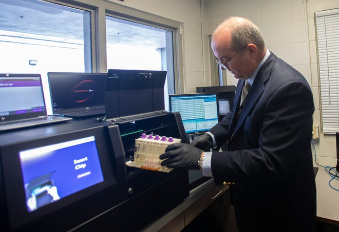 Chris Carney, DNA data for FDLE, demonstrates the Rapid DNA testing system at the Leon County Sheriffs Office.