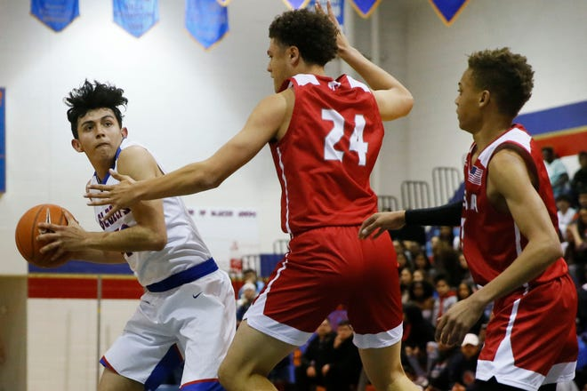 Americas' Damian Vicente goes against Odessa High defense in 6A boys basketball playoffs Tuesday, Feb. 25, at Americas High School.
