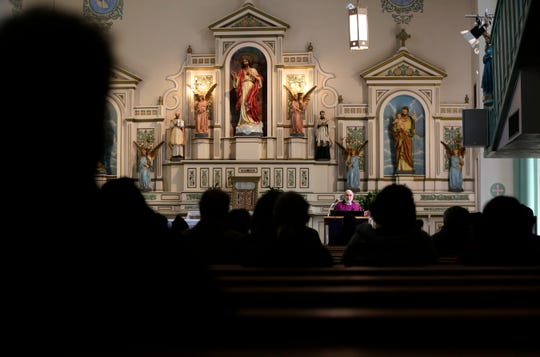 The Rev. Jose Luis Mesa celebrates an Ash Wednesday Mass at Sacred Heart Church in the Segundo Barrio. The church is considered by many to be the heart of the Segundo Barrio.