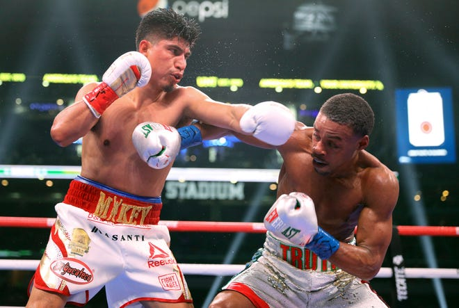 Pacifica High School graduate Mikey Garcia, left, tries to land a punch on Errol Spence Jr. during the sixth round of their fight on March 16, 2019, in Arlington, Texas. Garcia lost a one-sided decision. He will return to the ring Saturday night in Texas.