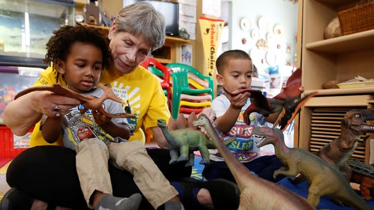 Child care provider Pat Alexander helps children Isaiah, left, and Hector identify various types of dinosaurs at her child care center in Elk Grove on Feb. 26, 2020. Gov. Gavin Newsom is proposing to consolidate the state's array of child care programs and to spend up to $10 million a year to create a new Department of Early Childhood Development. The plan has gotten some criticism from some child care providers who question the wisdom of spending millions to create a new bureaucracy.